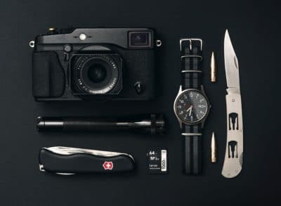 A watch with a Swiss army knife, compass, and camera.