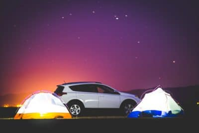 A car with two tents.