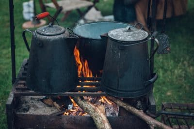 Kettle pots on a fire.