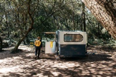 A man by a camper.