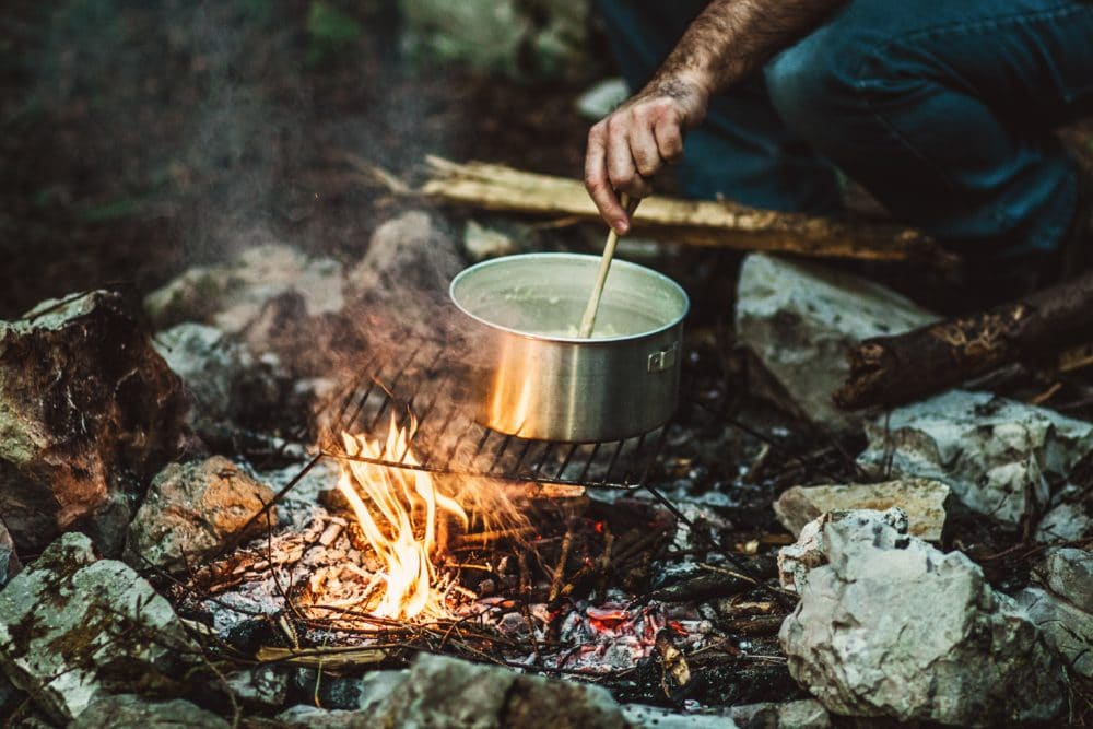 Cooking over a fire.
