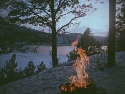 A campfire by a lake.