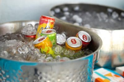 Two buckets of ice with cold drinks.