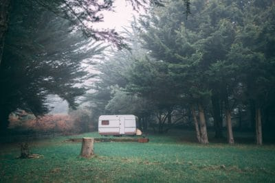 An RV in the woods.