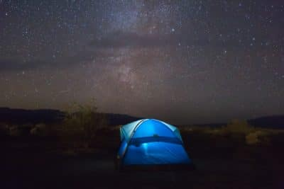 A tent at night.