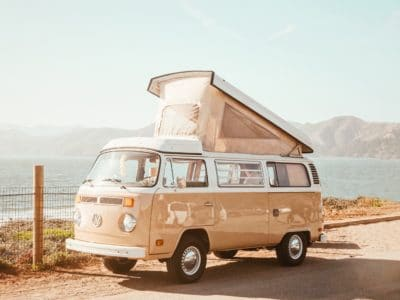 A VW bus with a popup top.