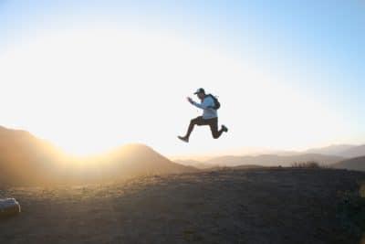 A guy jumping through the air.