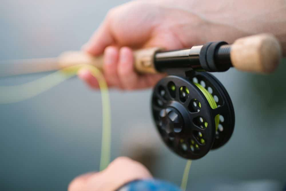 A fishing rod with a reel and a line.