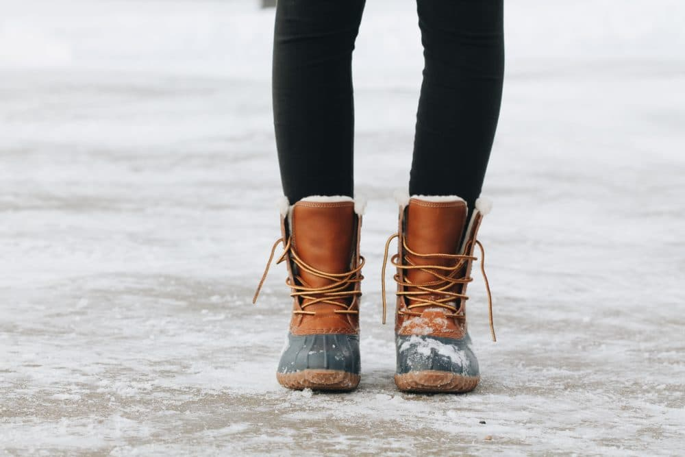 A pair of Duck Boots on ice.