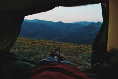 A view of the mountains from inside a tent.