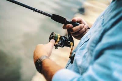 A man holding a fishing rod.