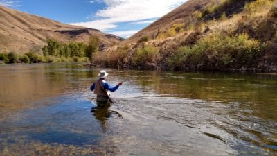 A man fishing in South Fork Boise River.