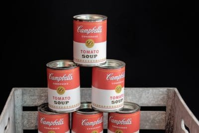 A stack of Campbells soup cans.