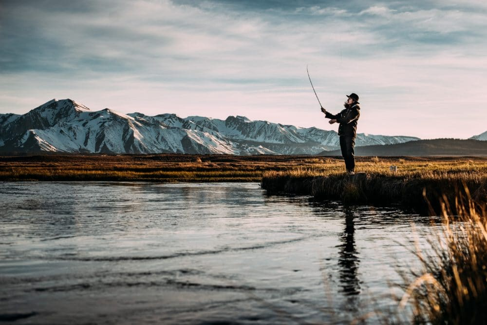 A man fishing in the wilderness.