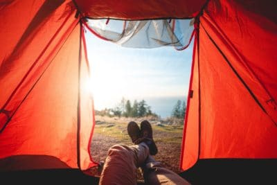 A view of the mountians from inside a tent.