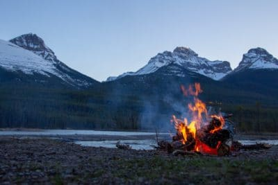 A campfire with mountains in the background.