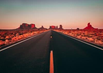 A road going through the Arizona desert.