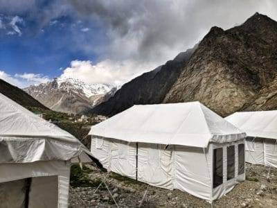 White canvas tents in the mountains.