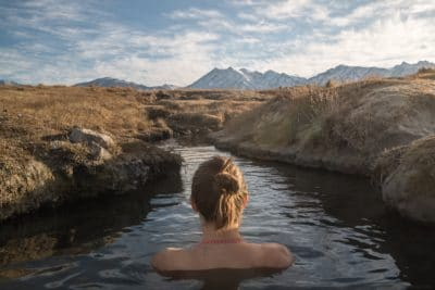 A girl in a river outdoors.