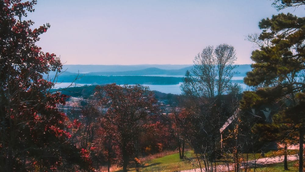 Remnants of morning fog remain over Table Rock Lake on an autumn morning in Branson, Missouri, USA.
