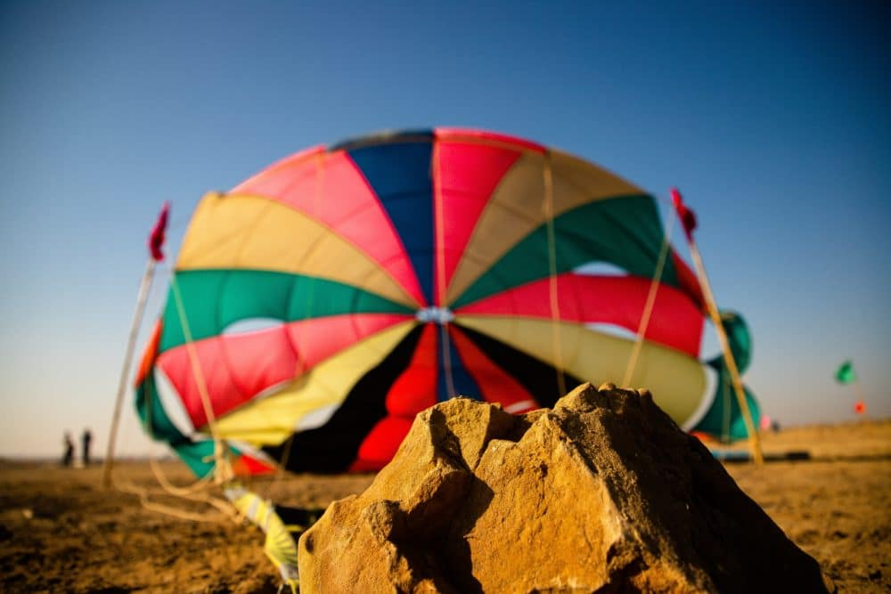 A colorful tent and a brown rock.