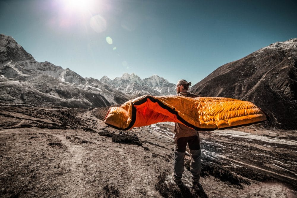 A man with a sleeping bag in Everest Base Camp Trekking Route, Khumjung, Nepal.