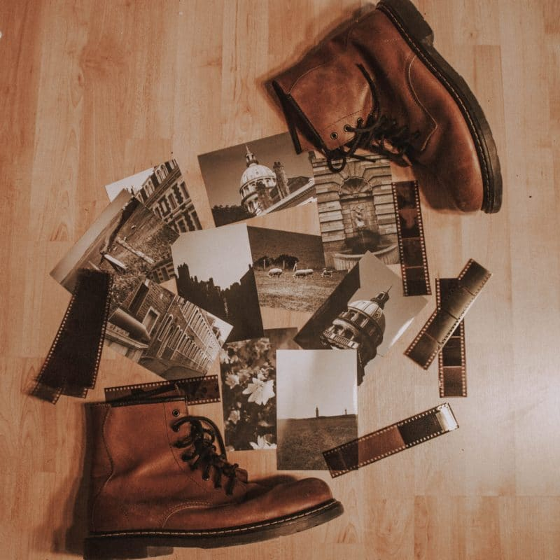 Photos between pair of brown leather boots on the floor photo.