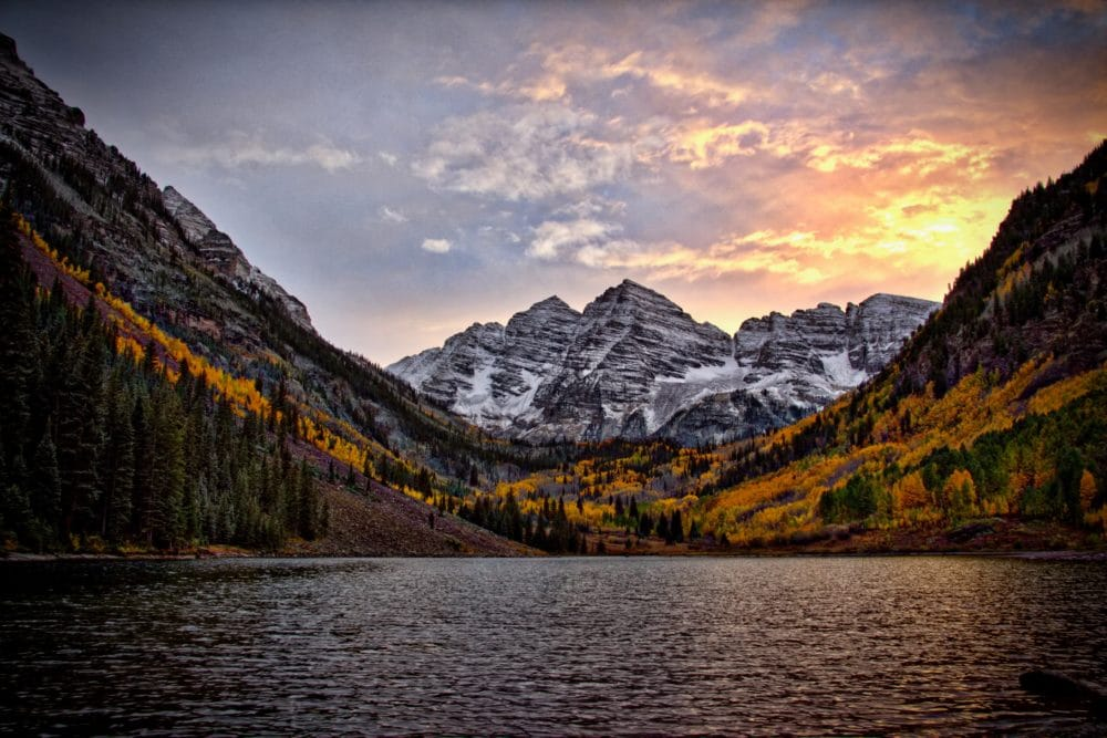 Body of water and a mountain in Colorado during sunset.