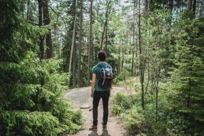 A man hiking in Tived, Örebro län, Schweden.