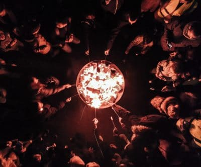 A group of people around a campfire.