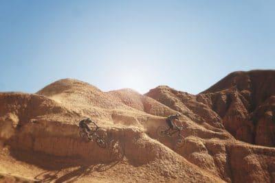 Two people biking in Arizona.