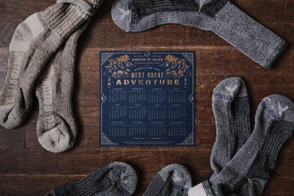 Pairs of gray socks around a sign.