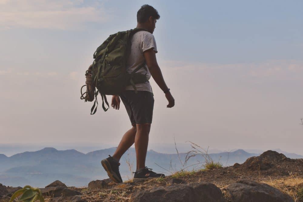 A man walking on a mountain.