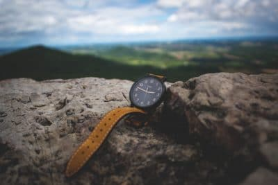 A Timex watch on a rock ledge.