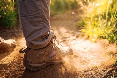 A hiking boot in the dirt.
