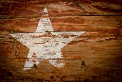 A white star on a wooden wall.