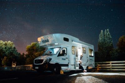 A white RV camper under the stars.