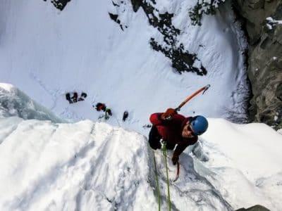 A person ice climbing.