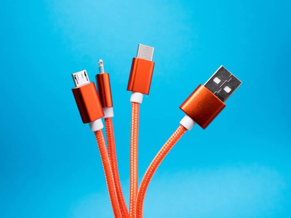 Orange USB cable with blue background.