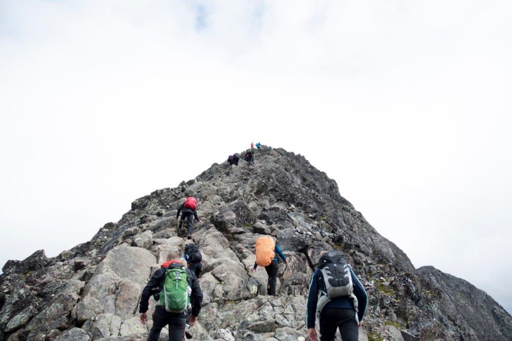 Climbers hiking up a mountain.