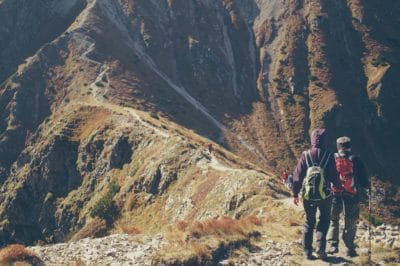 Two people hiking through the mountains.