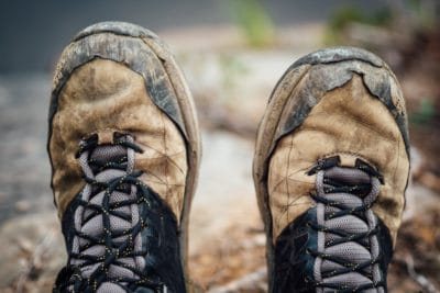 A pair of brown worn in hiking boots.