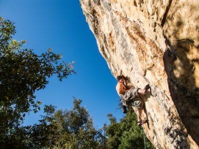 A person rock climbing.