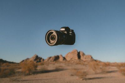 A DSLR camera in the air in the desert.