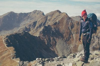 A hiker on top of a mountain.