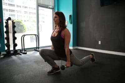 Woman exercising in a gym.