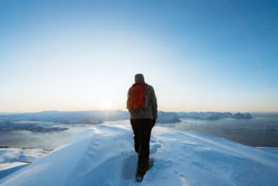 A man hiking in the snow.