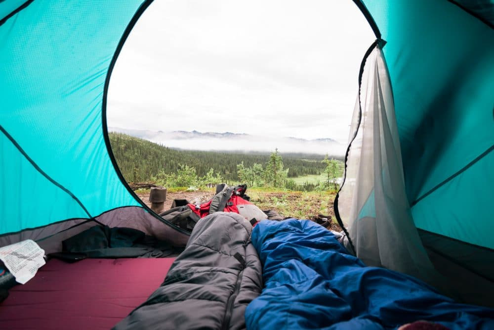 Two sleeping bags in a tent.