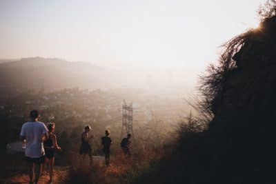 A group of people walking in the mountains.