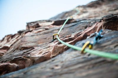 A climbing rope on a rock wall.